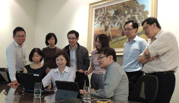 Ms Leong (seated 2<sup>nd</sup> from left) has launched several initiatives at different levels of technology that has benefitted the Group and created greater synergy