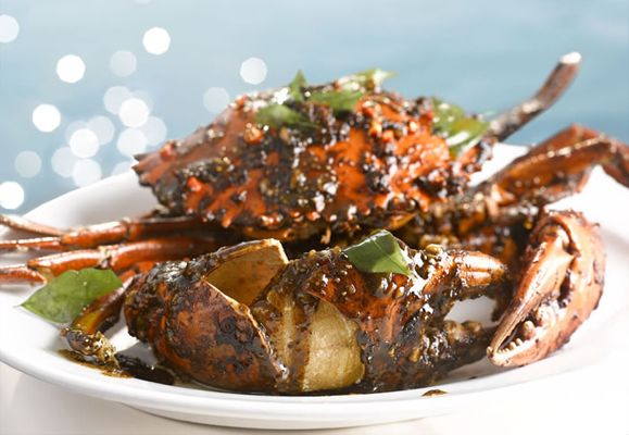 For seafood with a sea view, try the Sri Lankan Black Pepper Crab (S$60 per kilogram, minimum 1.3 kilograms) at Quayside Seafood Restaurant