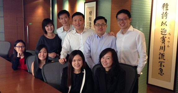 Mr Yong (standing 3rd from left) and his team; he values sharing and open dialogue with his staff and welcomes them to share their opinions with him as equals