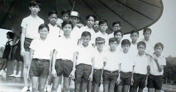 Mr Tan (standing 1st row, 2<sup>nd</sup> from left) on his first study trip to Kuala Lumpur, Malaysia while in primary school