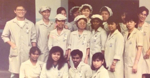 Mr Tan (standing 1st from left) worked as a production supervisor right after graduation, with 20 operators under his supervision