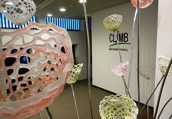 B. Jane Cowie's glass installation, New Growth, is befitting at the CapitaLand Institute of Management and Business (CLIMB) where CapitaLand employees gather to learn and grow