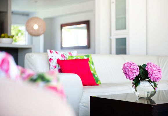 Freshen up your home with flowers and cushions to make your home more attractive and rent-worthy