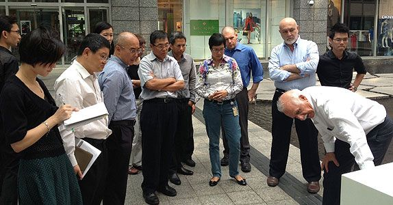Working with world renowned architect, Mr Moshe Safdie (right in white), on Raffles City Chongqing, was an valuable experience for Ms Cheng (centre), seen here reviewing the façade materials for the mixed development
