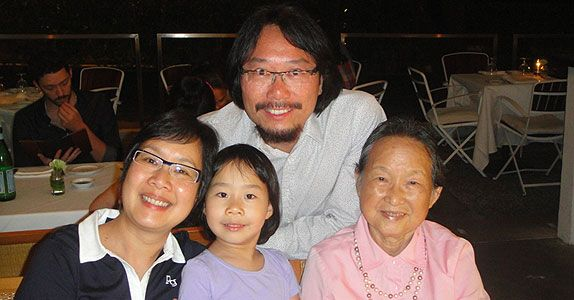 Ms Cheng with her husband, daughter and mother