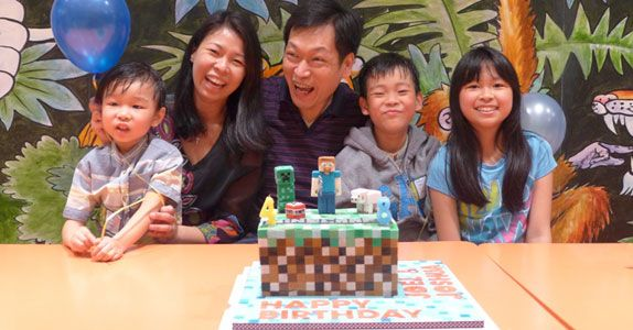 Mr Goh having a precious family moment at a birthday celebration when his youngest son, Joel (left) turned 4 and Joshua (2nd from right) turned 8