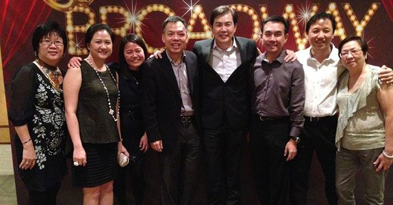 Vincent (4th from left) with Mr Lim Ming Yan, President and Group CEO of CapitaLand Limited (5th from left) and fellow colleagues at the Group's annual Dinner and Dance in 2013
