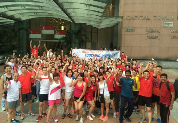 Team Singapore gathered outside Capital Tower to launch an Ascott-led company-wide, global campaign, Moving Feet, Touching Lives