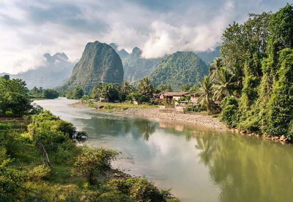The idyllic town of Vang Vieng is one of the best examples of Vientiane's laid back charm