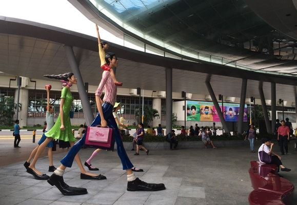 Kim Gyung Min's sculpture Shopping with the Family at Bedok Mall greets the public at the mall's entrance and blends into the everyday lives of the community