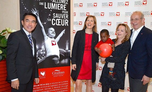 Mr Ong (left) at the opening of the Les Lumières Citadines du Coeur ('Citadines Heart Lights'), a fundraising campaign that enables children with heart defects to receive medical treatment.