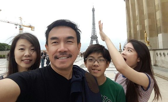 Mr Ong with his wife Cindy, daughter Deirdra and son Braxton spend some quality family time at the Eiffel Tower.