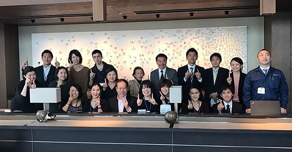 Mr Tan (in white shirt, seated in the middle) and his team as they prepare for the opening of the Ascott Marunouchi Tokyo.