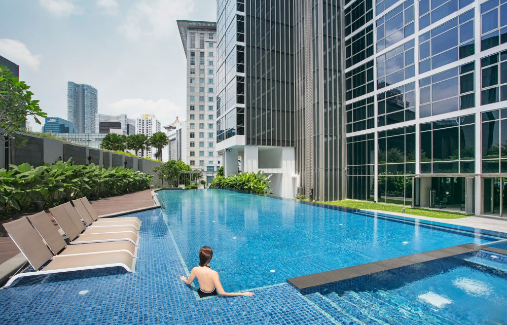 Stunning poolside views worth travelling for capitaland for Gay in singapore swimming pools